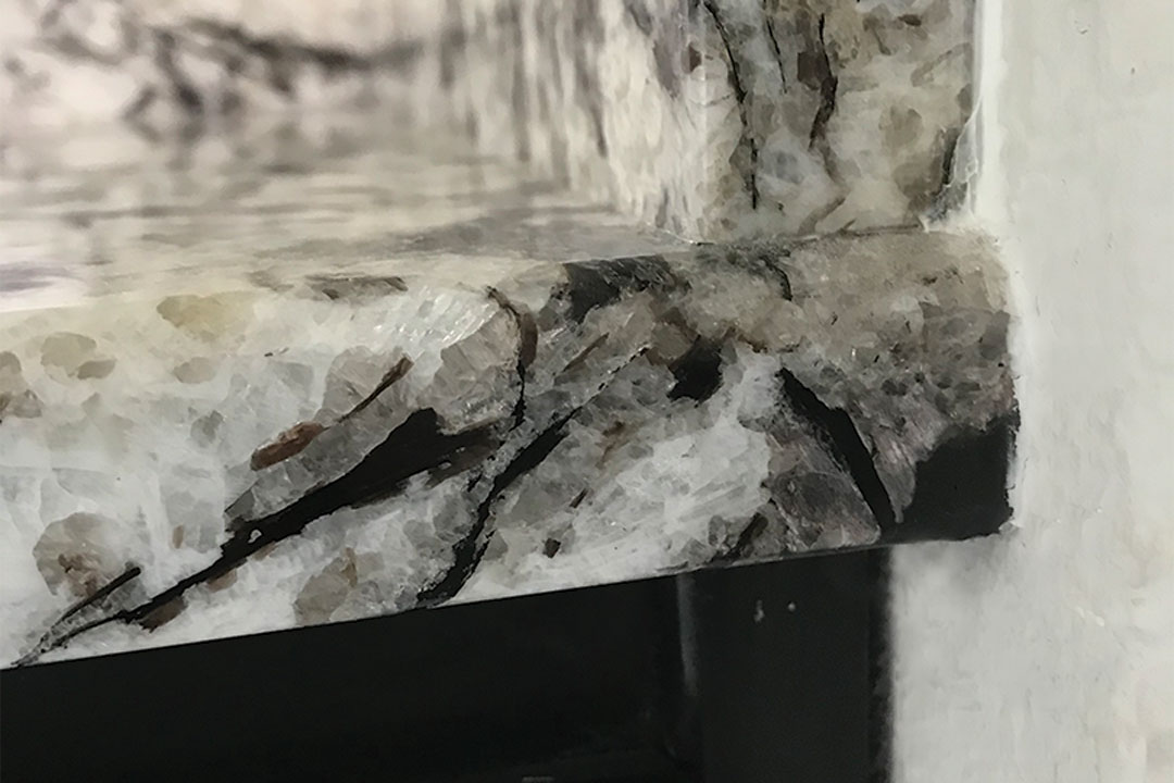 closeup of granite putty on the chip