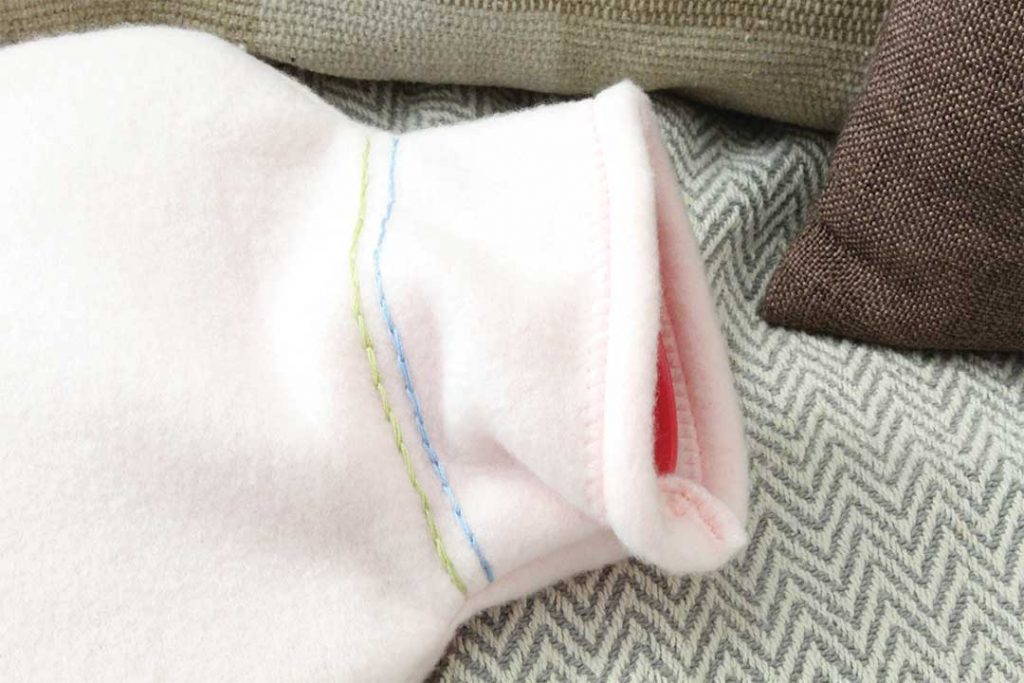 overcasting and reinforcement stitch at openings