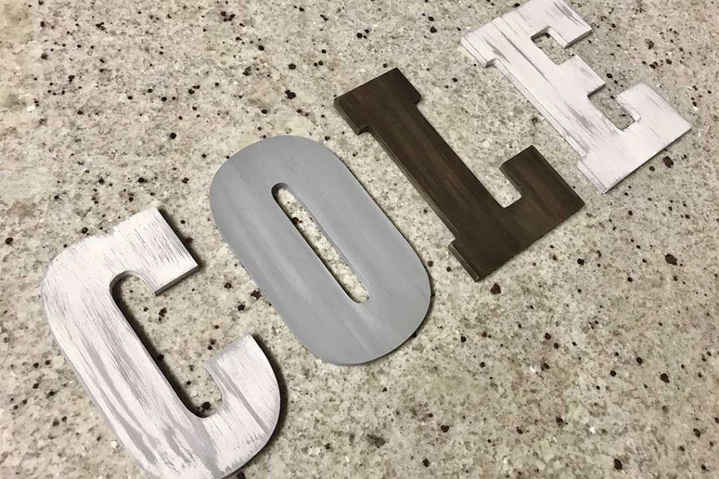 painted and distressed wood letters