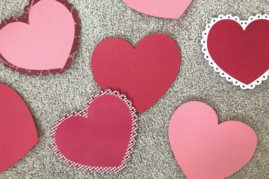 Valentine's Day tradition for kids, paste hearts together