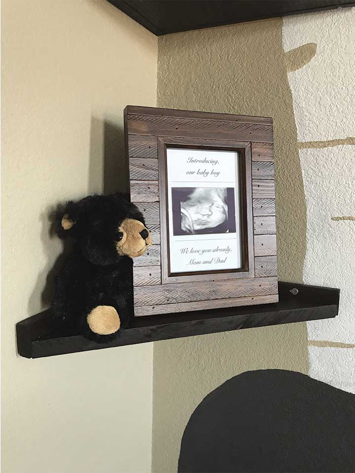 DIY wood corner shelves with wood picture frame and black bear.