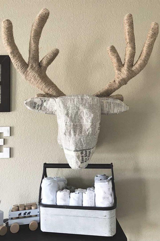 front view of diy paper mache deer head in woodland nursery