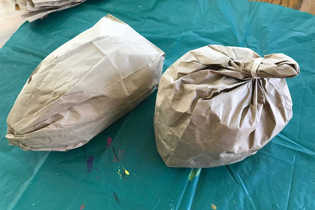 brown paper lunch bags stuff with packing paper to form head and neck shapes of the deer head