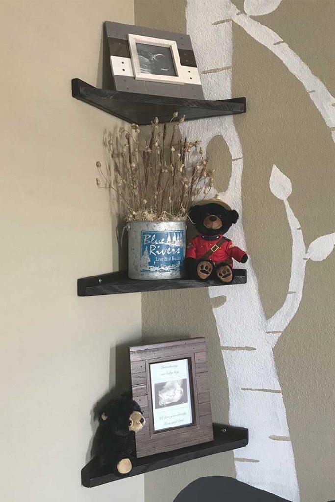 DIY floating corner shelves decorated for a woodland nursery