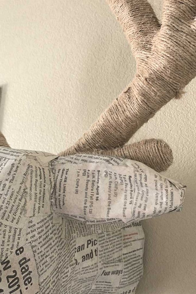 close-up of twine and newspaper on paper mache deer head