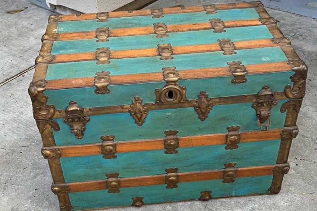 antique metal-clad steamer trunk painted turquoise